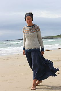 Sweater with long, flowing skirt and hair wrap. This is a lovely and practical look. The sweater is a lovely one too. (Link to Ravelry pattern page, although this is beyond my skill level.)