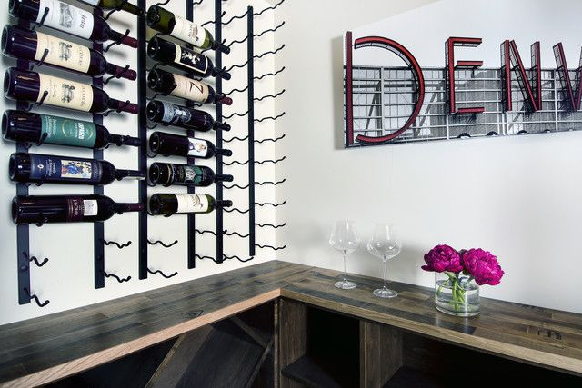 Mixed media wine storage with wire wine racks and wood wine cabinets below. Denver.