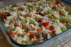 Cheryl's looked more green than this picture, maybe more peppers? Sausage Rice Casserole 1/2 c. dry rice 1 envelope Lipton Noodle Soup 2 1/2 c. water 1 lb. sausage 1/2 bell pepper, chopped 1/2 onion, chopped 3 stalks celery, chopped 1-2 c. grated cheese