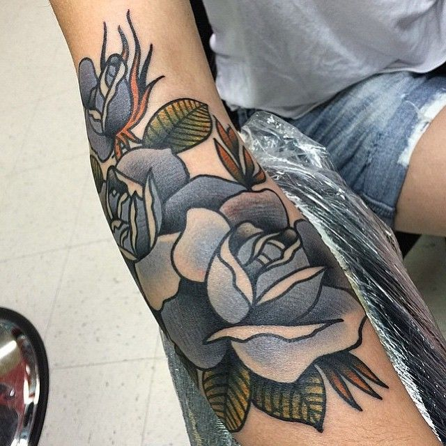 Grey roses tattoo. piece by @toothtaker