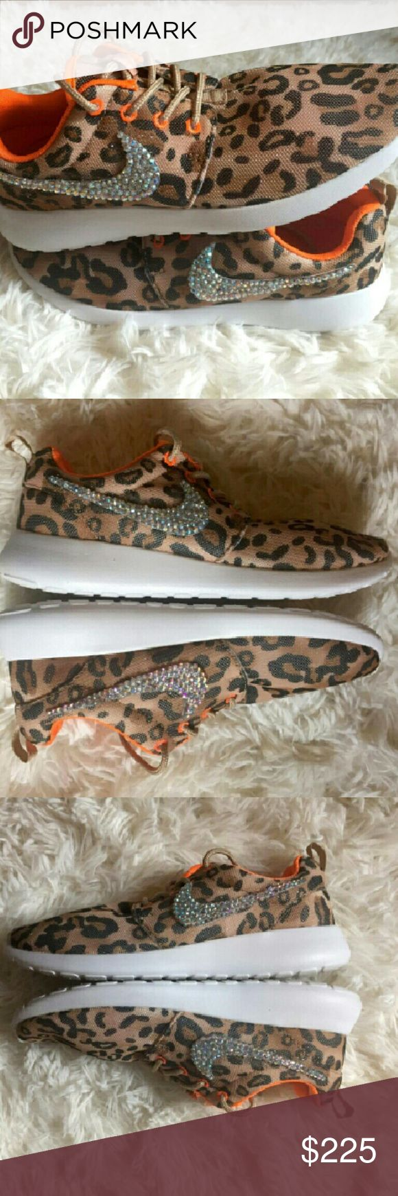 Super rare limited edition nike leopard roshe run Only worn once. Fresh brand new swavorski crystals. Warranty on crystals. You won't find these anywhere. Extremely rare leopard/hunter orange nike roshe run tennis shoes. Size 8/run like a 8.5. One of a kind Christmas present. Come with box. Nike Shoes Athletic Shoes