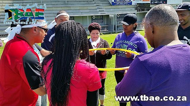Hule Hoop Down Team Building Activity #SAPD #TeamBuilding #CorporateFunDay