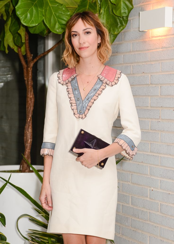 To a party in New York, director Gia Coppola wore a Gucci Spring Summer 2016 cocktail dress with multicolor trompe l'oeil sequin embroidery and a deep purple plexiglass clutch with star and bee stud details.