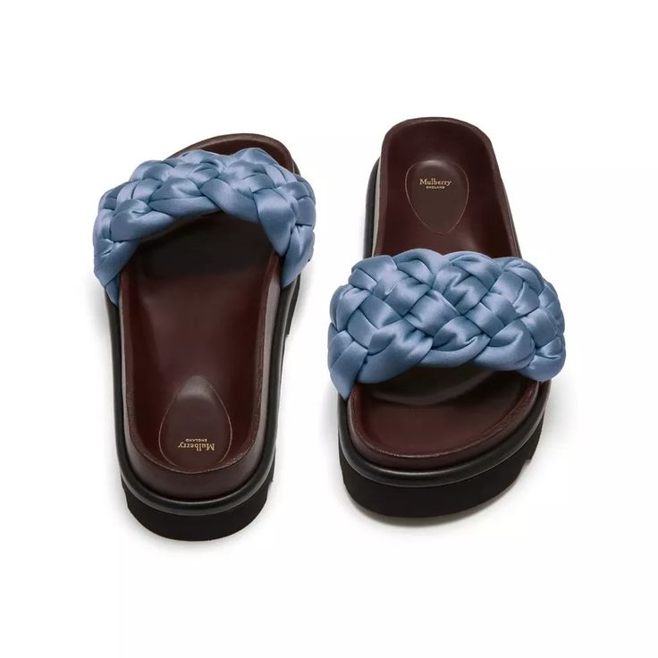 Shop the Braided Slides in Frozen Satin at Mulberry.com. Inspired by braided equestrian detailing and the plaiting of horses tails, these slip-on slides feature a classic braided wide satin strap in soft calfskin leather.