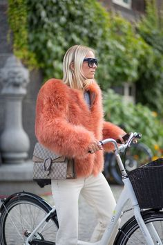 Cycle-chic street style fur look in Copenhagen