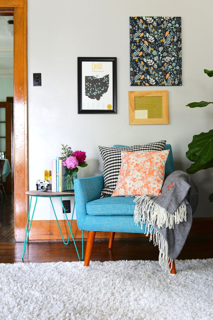 Love the splashes of colour. Especially the orange pillow and the blue of the chair