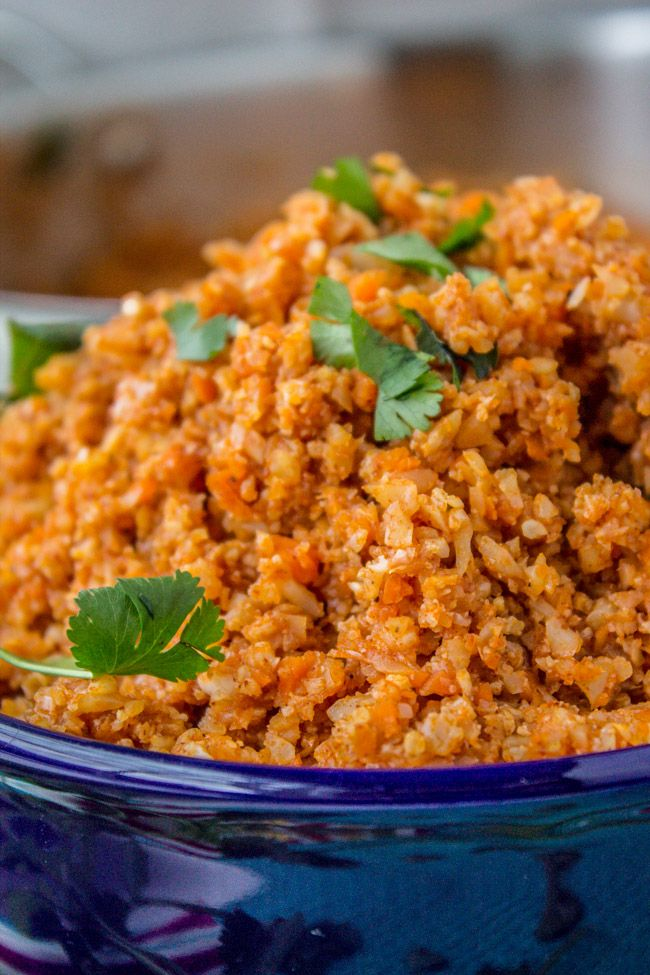 Spanish Cauliflower Rice (to eat with Mexican Food) from The Food Charlatan - for lower carbs, skip the carrots.