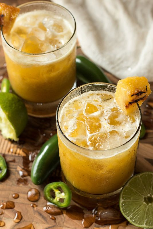 Grilled Pineapple and Jalapeno Mezcal Margarita - Mezcal, Jalapeno Infused Tequila (Recipe), Orange Liqueur, Grilled Pineapple, Lime Juice, Honey, Pineapple Juice, Grilled Pineapple and Lime Wedges for Garnish.