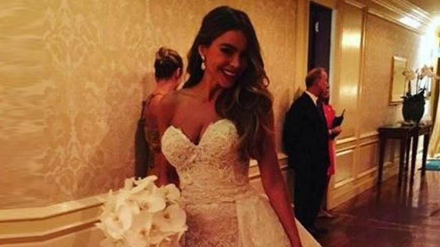 The 'Modern Family' star says 'I do' to her price charming in a dress fit for a queen.