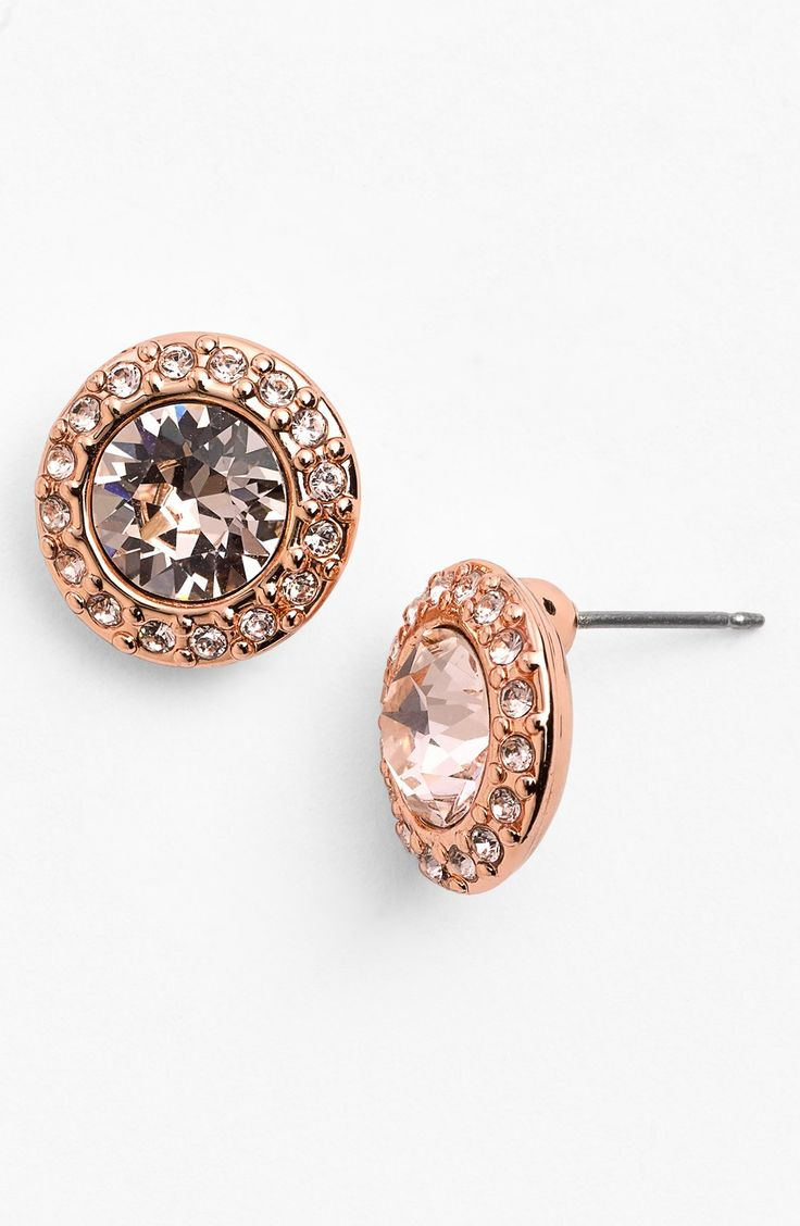 Pairing these sparkly blush-hued studs with a pearl necklace and a fit and flare dress | Givenchy pavé stud earrings.