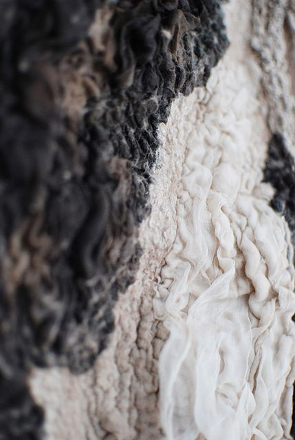 ((Texture : Textile)) Fabulous piece....the ivory and the indigo...such raw nubs of texture. Texture adds so much to a garment, deepens it and is so lovely to fun your fingertips over the surface! This is definately a face-plant piece!