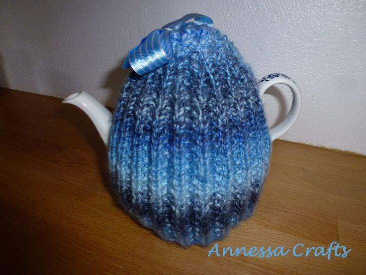 This is a tea cosy that mum made. It is knitted in rib and has a blue stripey ribbon on the top, find it plus many more colors on our website: annessacrafts.moonfruit.com!