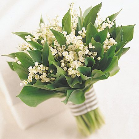 9) Floral arrangement(s): Simple & fragrant - and perfect for Spring - a lily-of-the-valley bridal bouquet. #modcloth #wedding