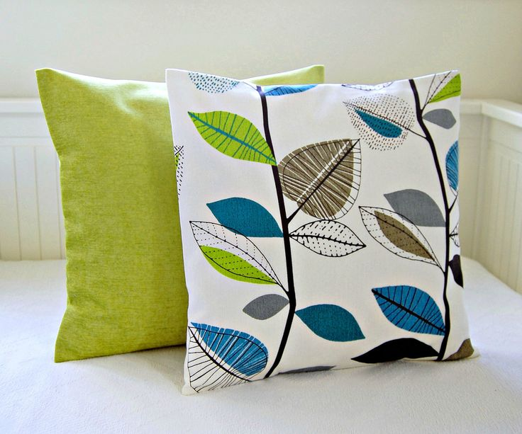 Love for the living room decorative pillows teal blue lime green leaves accent lime pair of cushion covers 16 inch. £28.40, via Etsy.