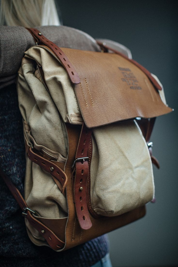 finelly organized backpack with few rollup pockets. canvas bag in a leather harness.
