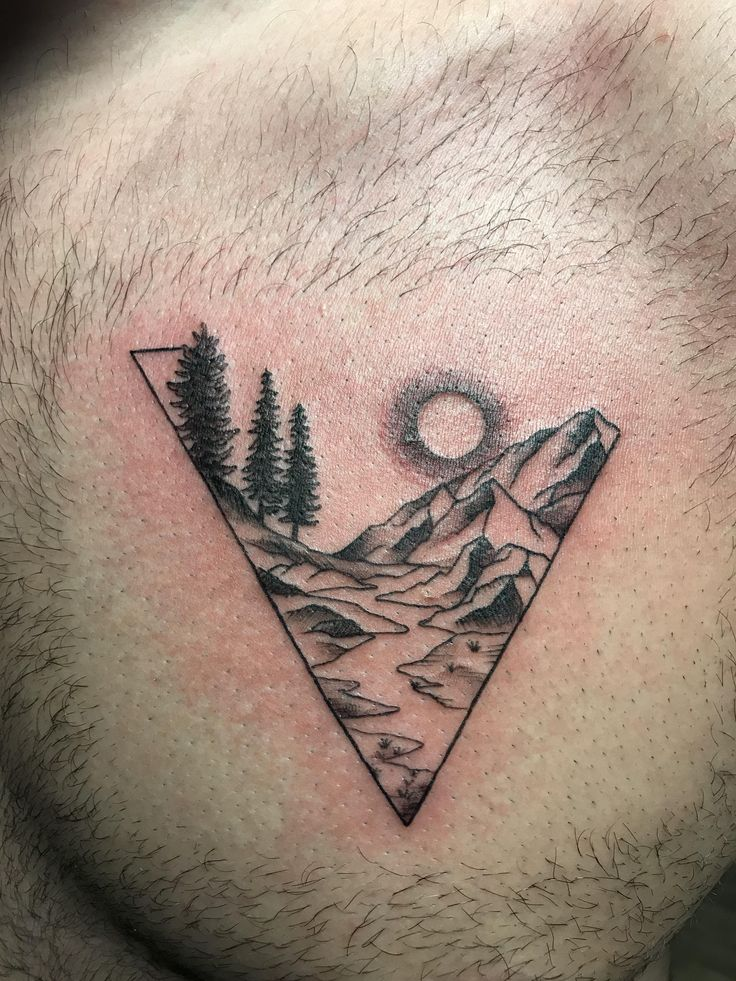 Mountain scene chest piece done by sara at tattoo art