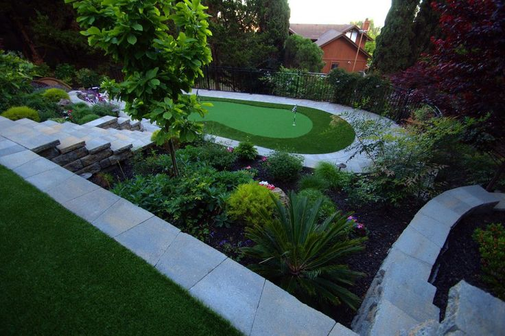 Backyard landscaping ideas landscape contemporary with retaining walls synthetic lawn