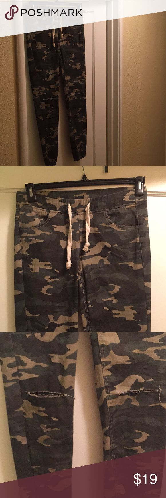 Camo skinny pants. New. Slits in both knees. New Active USA camouflage skinny pants. Elastic waistband with drawstring. Slits in both knees. Never worn, excellent condition. Active USA Pants Skinny