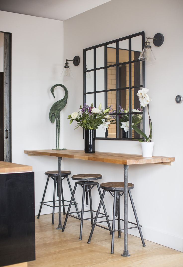 Vintage Industrial breakfast bar at The River Loft with old edision bulb lamps and crittall mirror  https://www.airbnb.co.uk/rooms/6347144