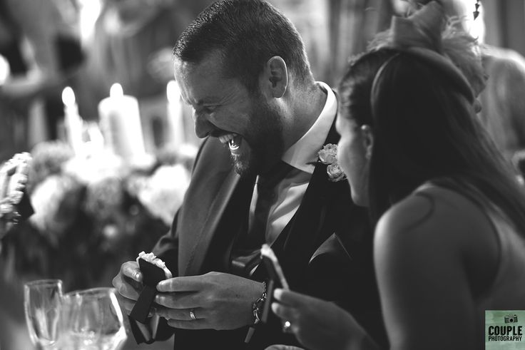 looking at their own facebook pictures on the tables. Wedding by Couple Photography https://www.couple.ie