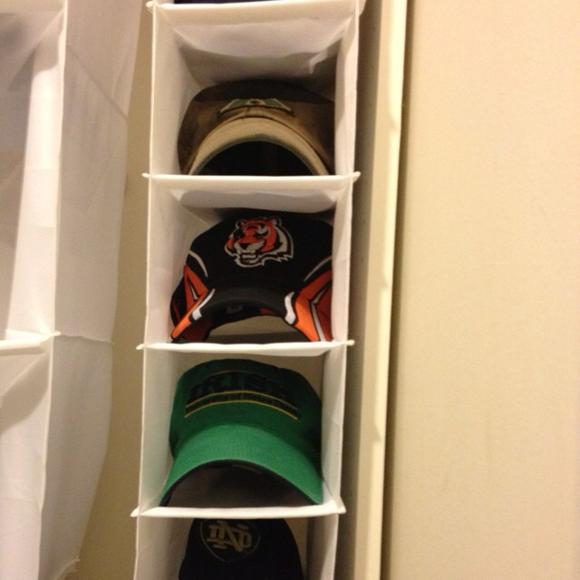 Keep those ball caps picked up! Ikea closet storage hanger works to stuff and store those pesky hats that get left all over!
