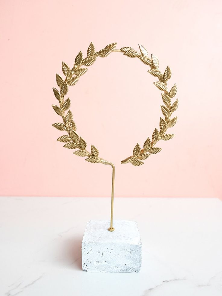 A gilded laurel wreath objet that you can make, not buy, we promise | DIY gilded laurel wreath objet, DIY laurel wreath sculpture, DIY sculpture, DIY home decor, home decor accents