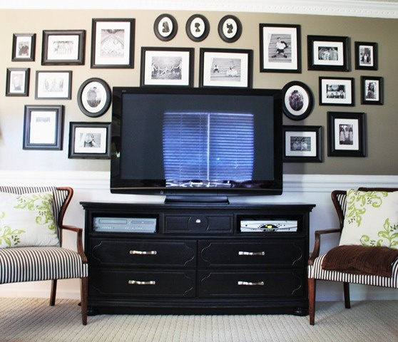 b&w picture frames. thrift store dresser turned tv stand