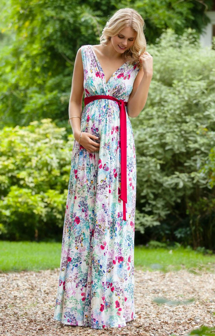 Das lange Umstandsabendkleid Anastasia im griechischen Stil mit atemberaubend schönem Mohnblumenmuster ist für jeden Anlass geeignet.