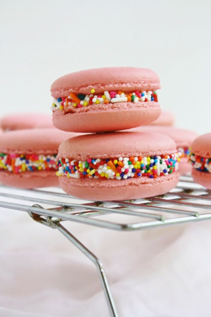 birthday macarons; pink macaron shells with a faux canned buttercream filling made with butter, cream cheese, heavy cream, milk powder, vanilla and butter extract