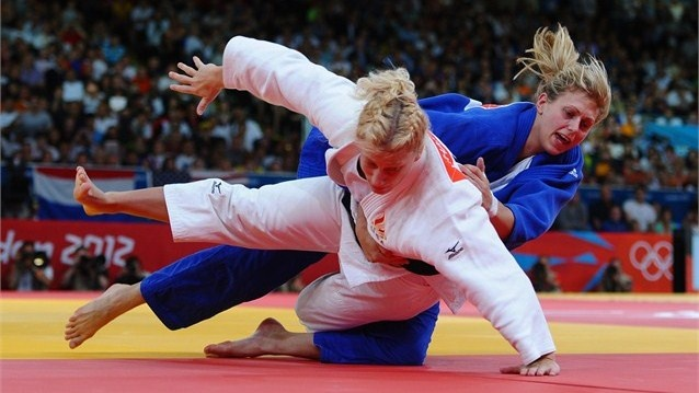 Kayla Harrison of USA and Gemma Gibbons of Great Britain compete for the gold