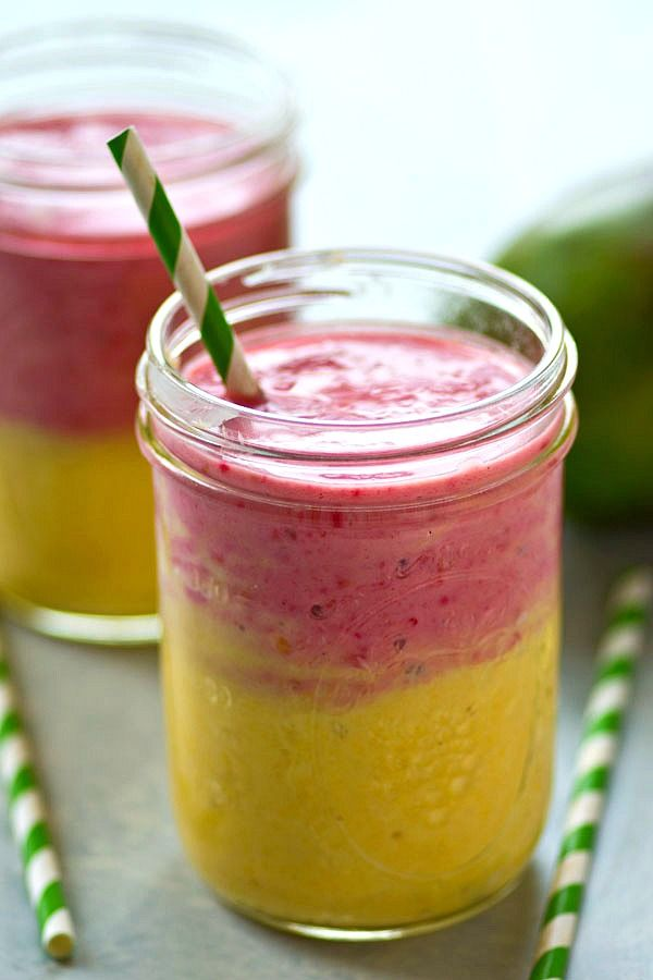 This pretty layered mango raspberry smoothie is SO easy to blend up you'll want to make it every single morning! The two colorful layers of smoothie goodness will start any morning off right.