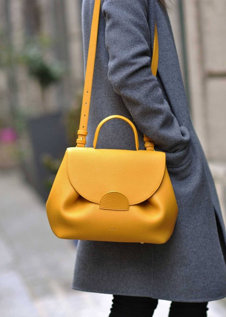 """Edition - Monochrome Yellow Undeniably feminine for its sensual curves, """"Number One"""" is Polène's signature handbag. Designed as a day..."""