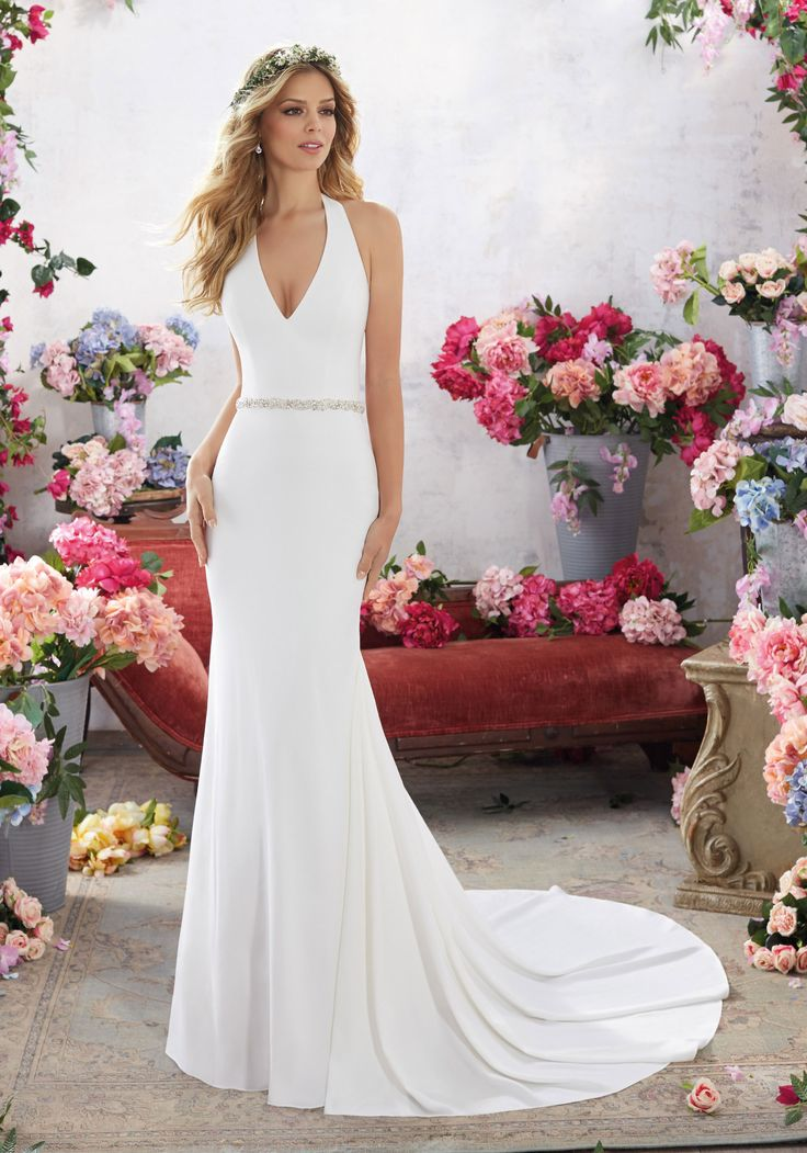 Designer Wedding Dresses and Bridal Gowns by Morilee. This Sheath Wedding Gown Features a Halter Neckline and an Open Back Accented with Beaded Criss-Cross Strap