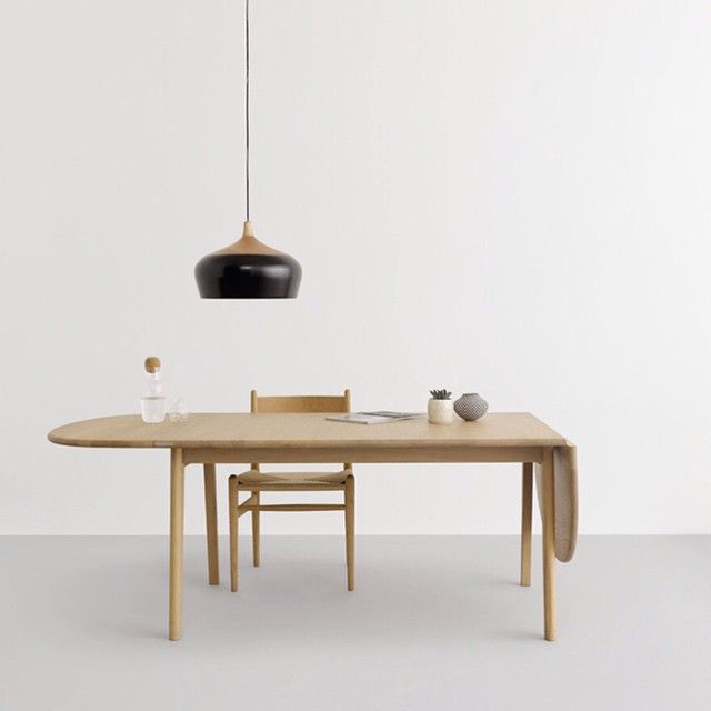 Coco Mini in black hanging low over a classic Hans Wegner CH006 dining table