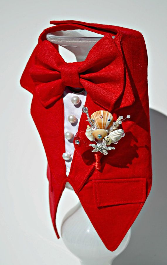 Tuxedo Red Linen Boy Dog Harness  DETAILS - Adorable boy dog harness made in red linen fabric - Can be made in other colors and other fabrics upon request. - D-ring for easy leash hook-up - Seashell boutonniere made from scratch. Each one will be unique! - Faux pockets and white buttons - Velcro closure under chest and at neck - Custom made to your pups exact measurements! - (Large dogs need to buy the large upgrade).  Matching top hat available for $45. Order here: https://www.etsy...