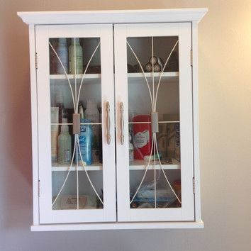 Features:  -2 Doors.  -Comes with instructions and hardware.  Product Type: -Cabinet.  Style: -Traditional.  Finish: -White.  Primary Material: -Manufactured wood.  Mount Type: -Wall mounted.  Glass P