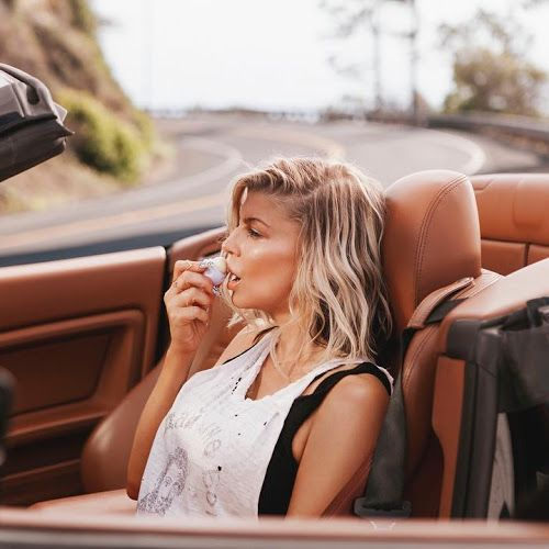 Fergie :  Eosproducts for keeping my lips soft while driving down the california coast