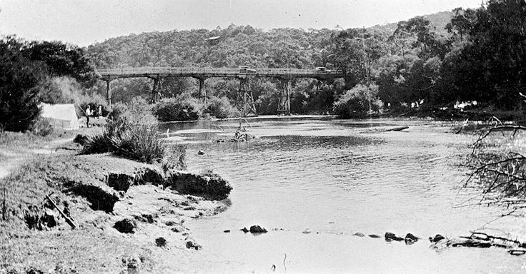A bridge over the Yarra River at Warrandyte. There is a camp site on the left bank. 1925.