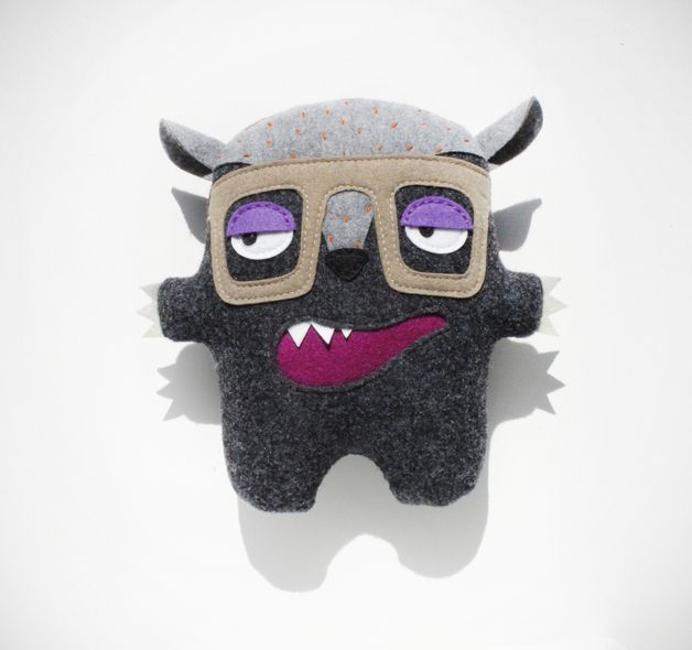 This crazy creature is called Bambak. He comes from Poland and he is fully huggable.  He is handmade from gray ecofriendly felt and firmly stuffed with hypoallergenic fill. He is approximately 24cm...