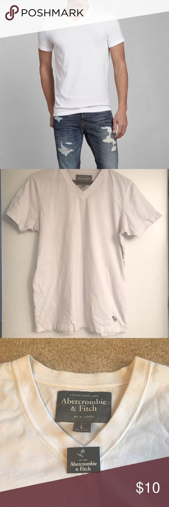 Abercrombie Men's White V-neck Tee Classic tee! This is new with tag, but was stored for a long time. There are faint marks in the inner lining shown above, but these are not seen when worn. Abercrombie & Fitch Shirts Tees - Short Sleeve