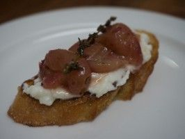 Roasted Grape Ricotta Crostini - Picture is sub-par, but this dish is tasty as either an appetizer or a dessert.