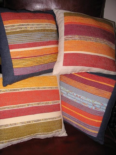 Frame cloth around handwoven piece to make pillow.