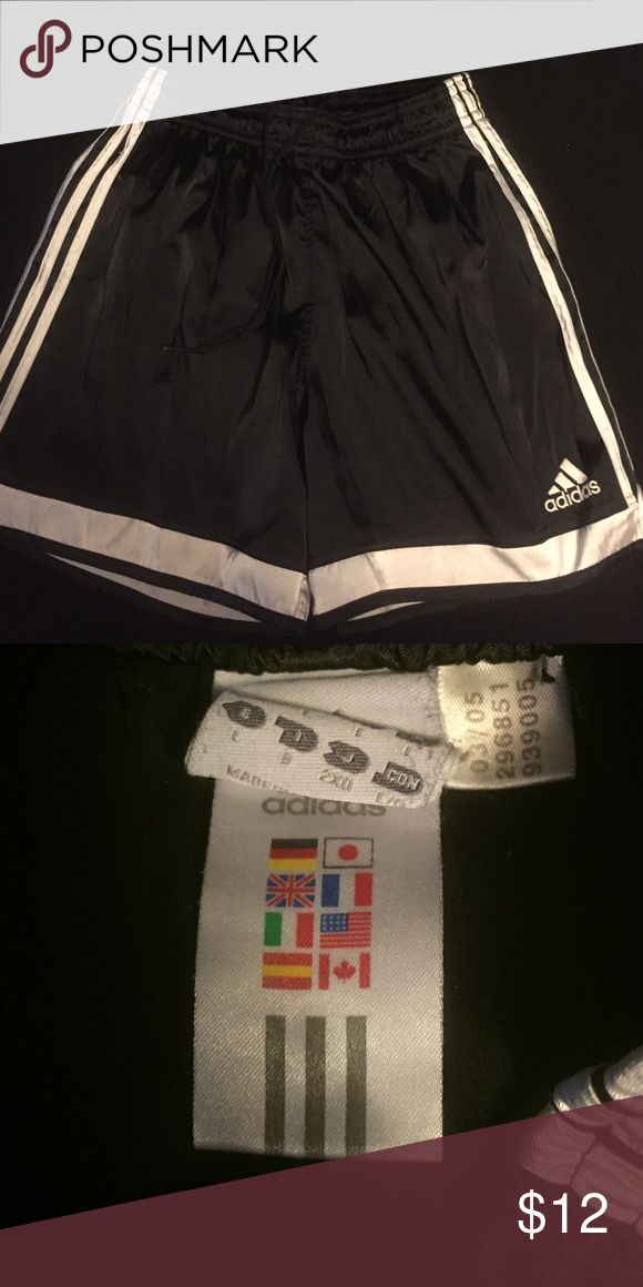 Adidas soccer shorts Black w/ white striped Adidas soccer shorts.  These are a size Large but fit very small like soccer/running shorts. Shorts Athletic