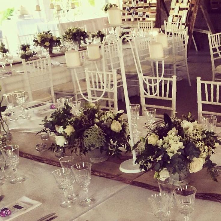 The table decor from the beautiful McCallum wedding which included our raw wood table runners, tealight candle votives and assorted single stem bottles.