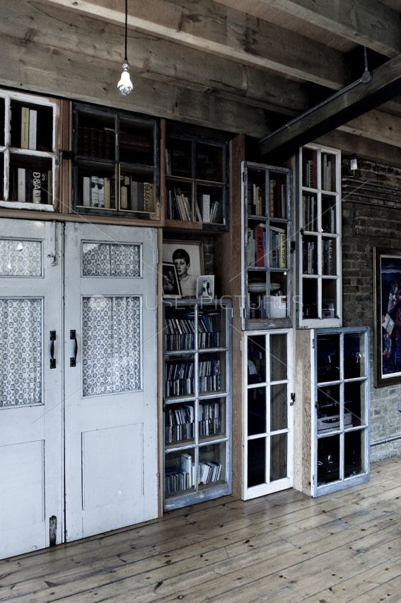 Industrial soul and warmness | Old windows as bookshelf cabinets