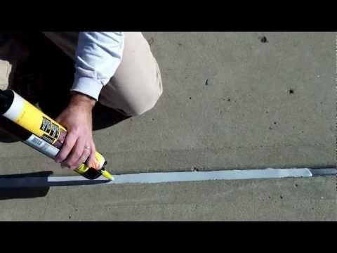 Apply self-leveling concrete joint sealant to expansion joints in concrete to avoid having to weed all the time.