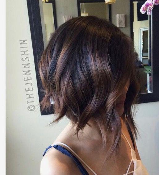 Dark brunette bayalage with low light subtle highlights. Great short bob.