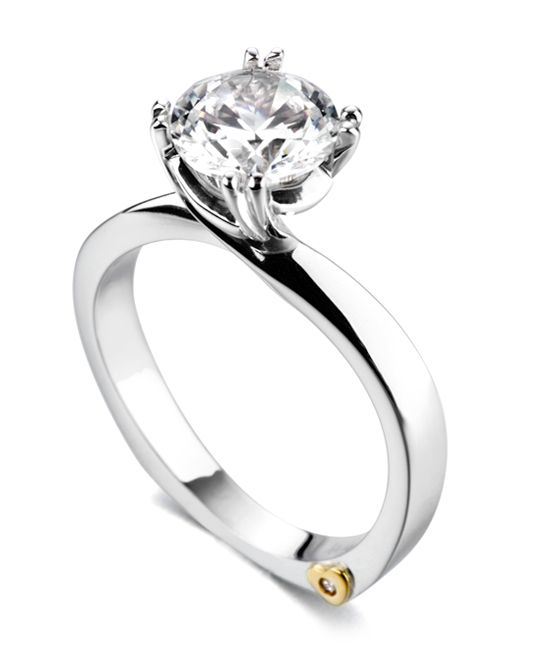 The Beloved engagement ring contains 1 diamonds, totaling 0.005 ctw. Center stone sold separately, not included in price.The Beloved wedding band contains 25 diamonds, totaling 0.25ctw. A band with no diamonds is also available.