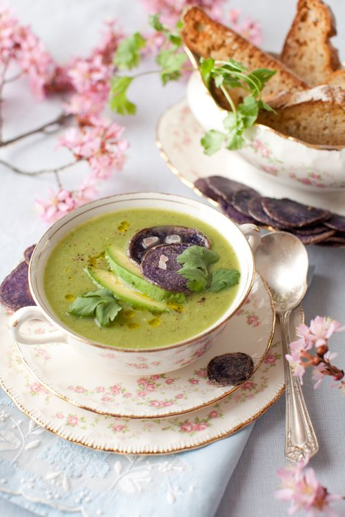Spring vegetable soup...2 tablespoons olive oil 2 leeks, white parts only, thinly sliced 2 1⁄2 cups green beans cut into 2-inch pieces 2 1⁄2 cups small broccoli florets 2 medium zucchinis, sliced 5 cups vegetable stock (or water) Salt and freshly ground pepper  4 tablespoons minced cilantro 3 purple potatoes, thinly sliced olive oil to fry