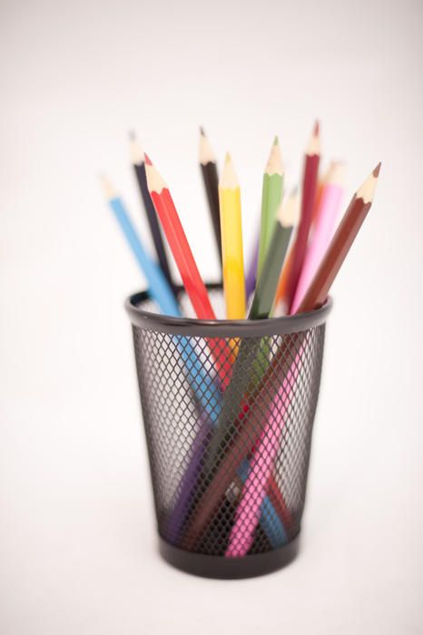 Free Stock Photo: Coloured office pencils standing upright in a small metal container ready for use - By freeimageslive contributor: gratuit